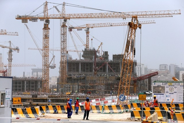 construction workers at building site in doha