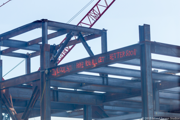 construction workers write sweet messages on steel beams for kids in hospital