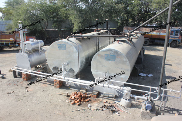 Asphalt heating and storage tanks